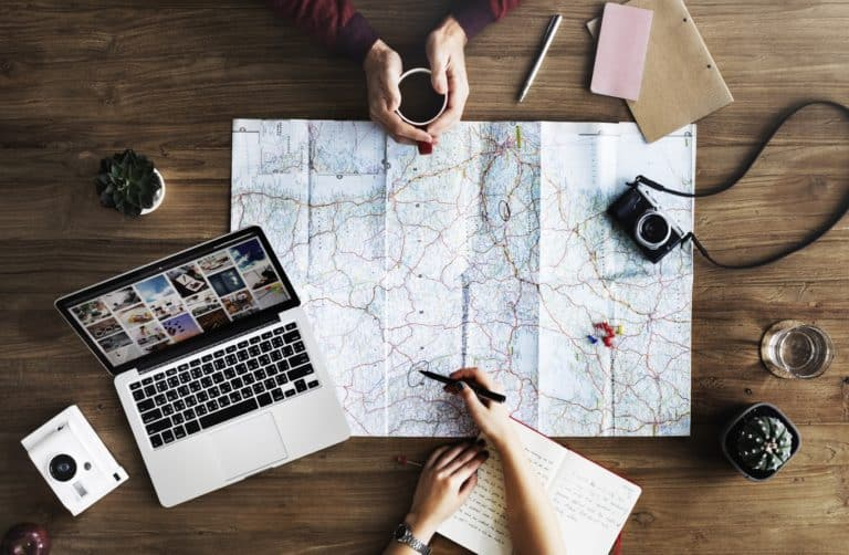 couple travel planning with map