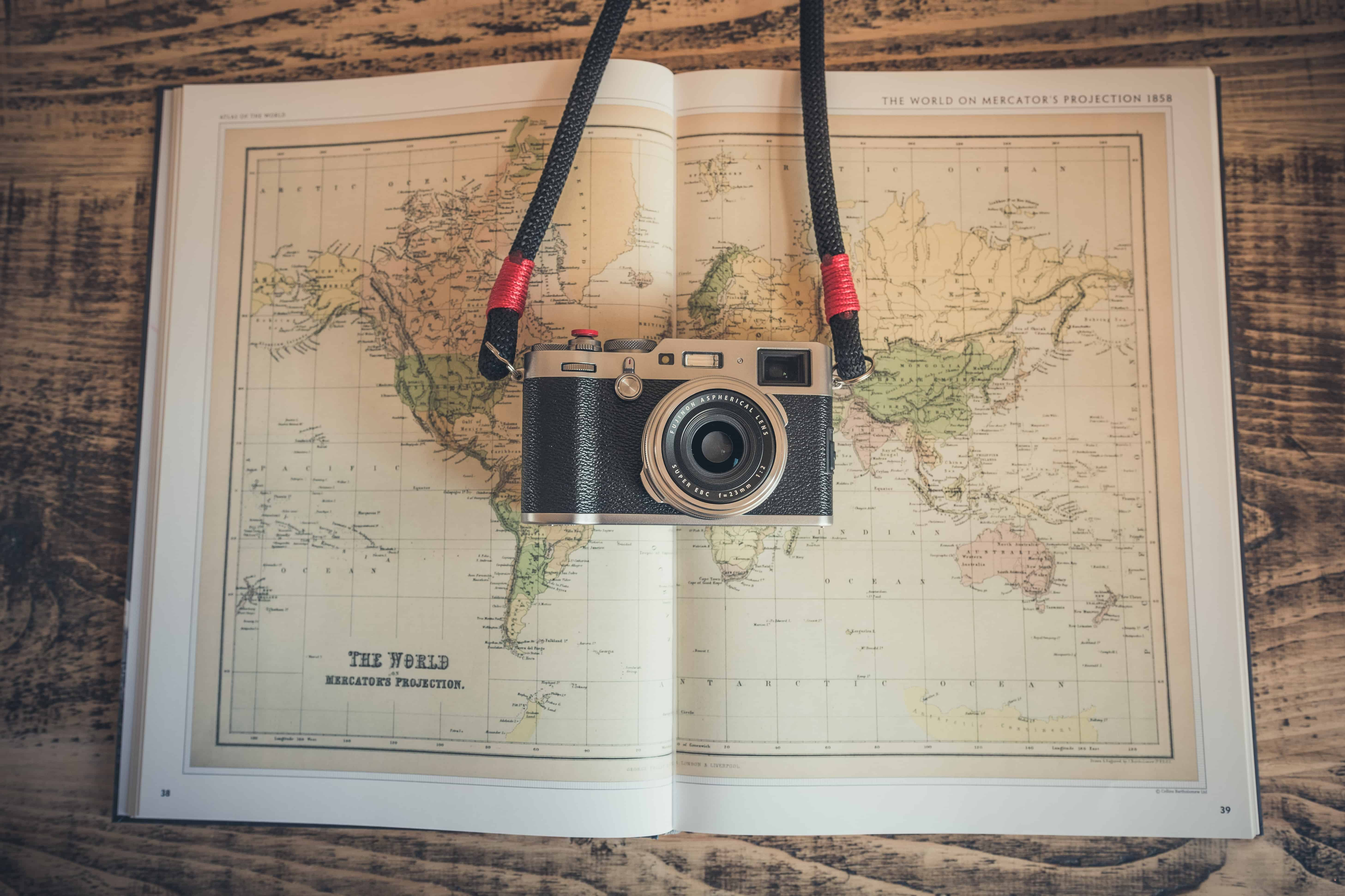 camera on top of a world map book